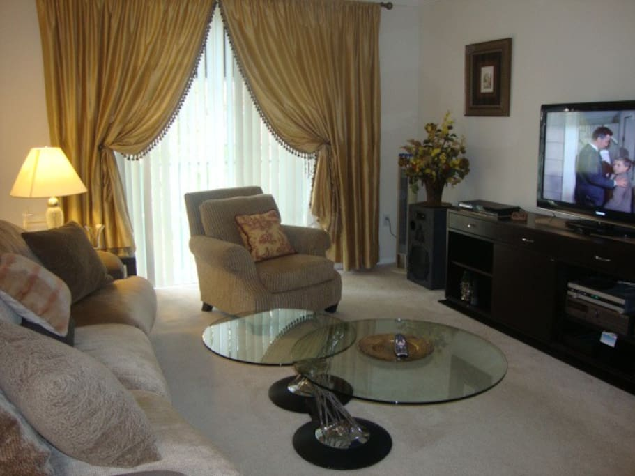 Living room, comfy chairs, Large-Screen HD TV