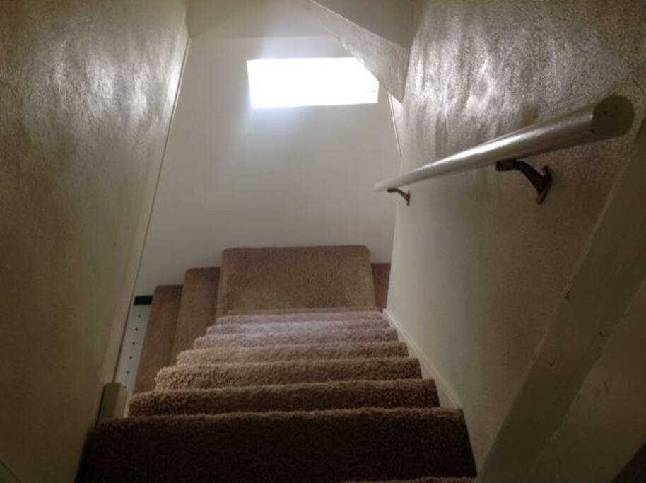 Stairs to the downstairs bedrooms and laundry/bathroom