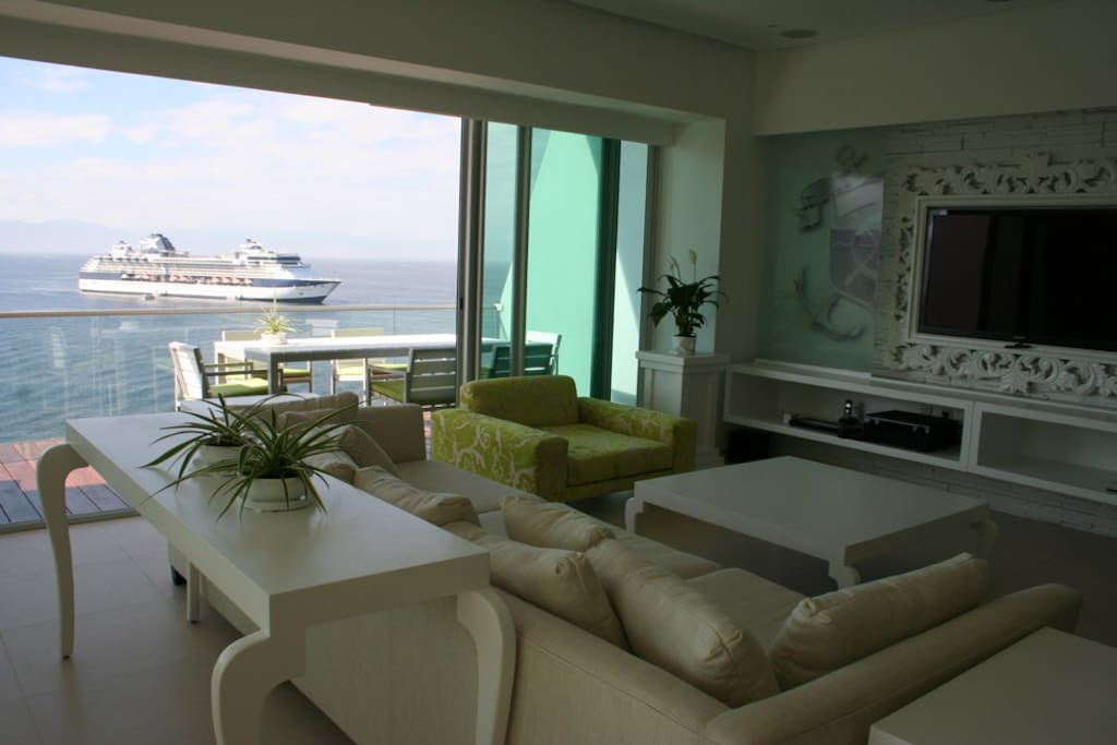 Living room and deck dinning set with stunning ocean, bay, & down town view!