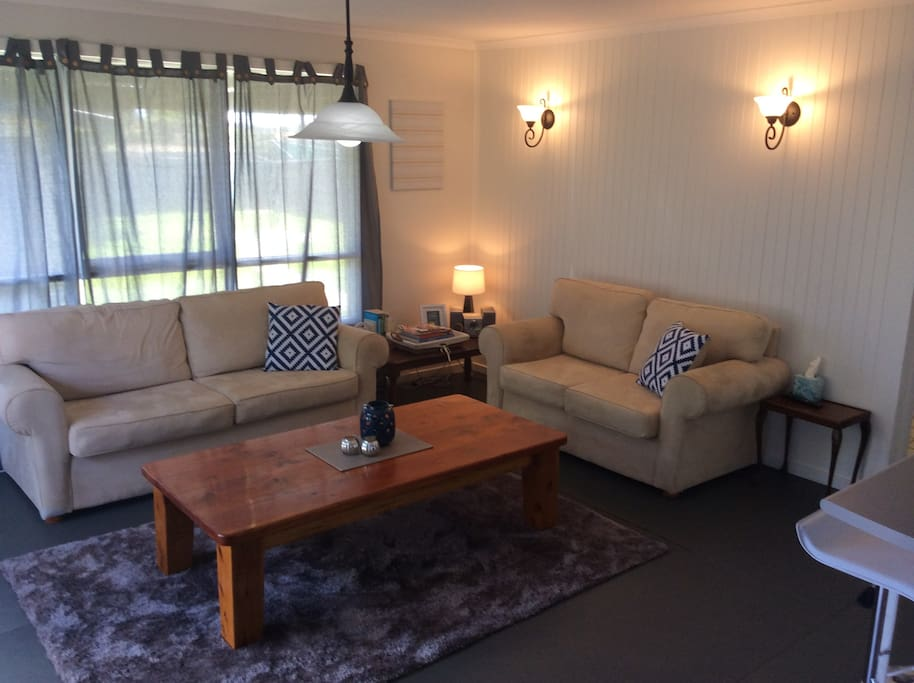Spacious loungeroom with gas heater and split system (heater/air conditioner)