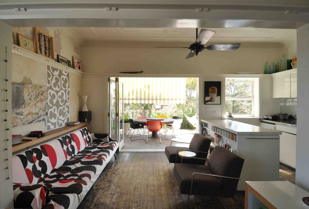 The living room opens onto a large terrace