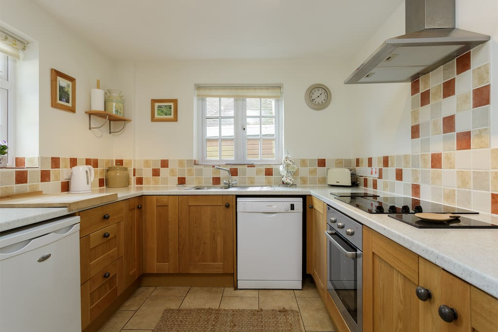 Everything to hand in the well laid out oak fronted kitchen