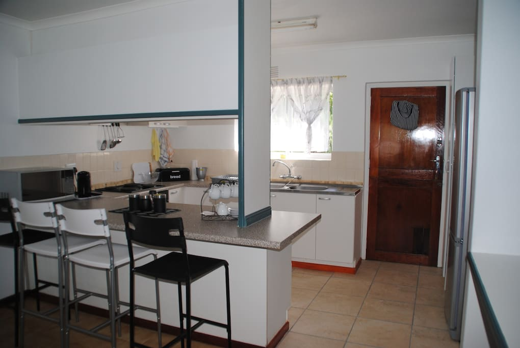 Open plan Kitchen with microwave, stove and fridge/freezer