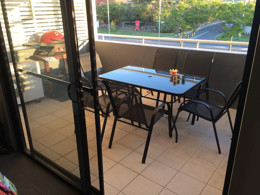 Large undercover balcony with 6 seater dinning table and BBQ