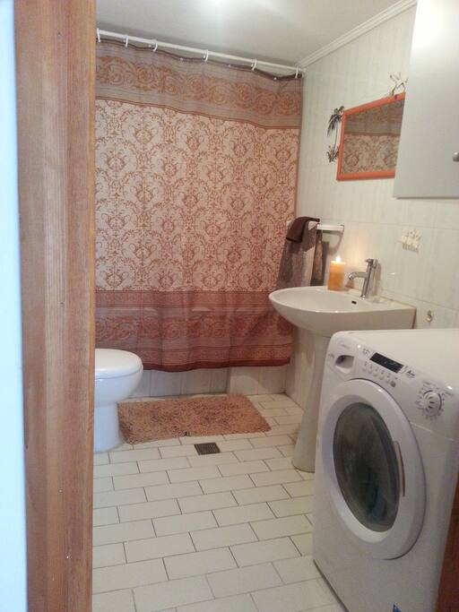 Bathroom with a washer that is also a dryer