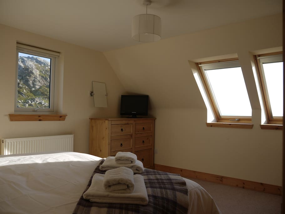 The gorgeous twin aspect Cottage bedroom