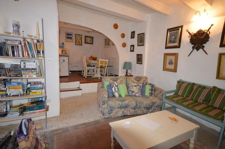 sitting room, kitchen / diner through arch.