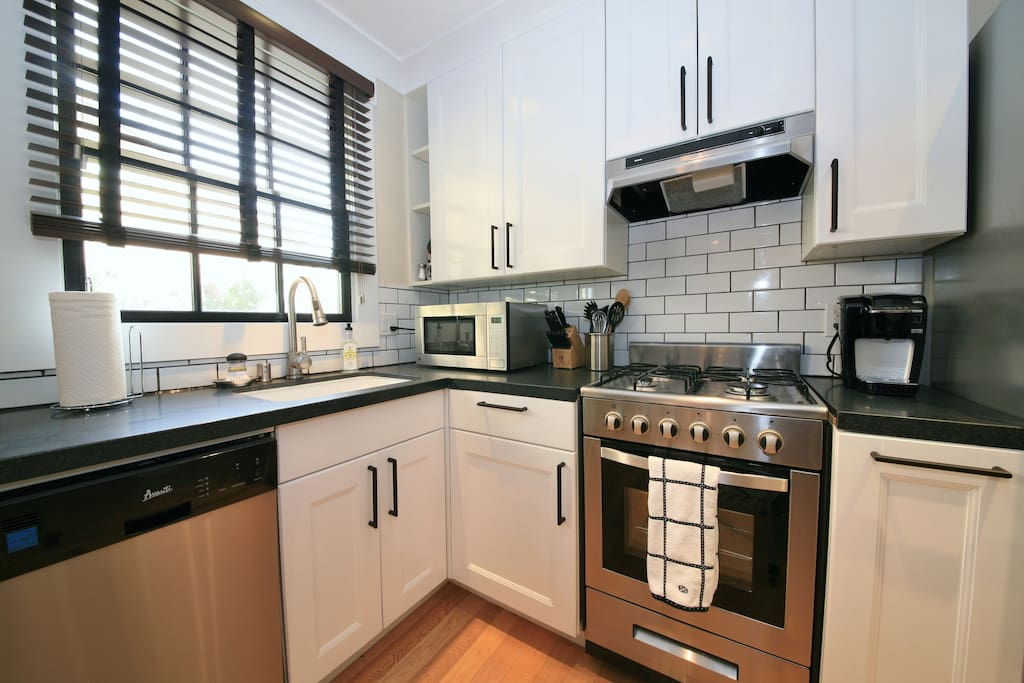 A fully-appointed European-style kitchen makes cooking easy and convenient. The rose garden is just outside the window.