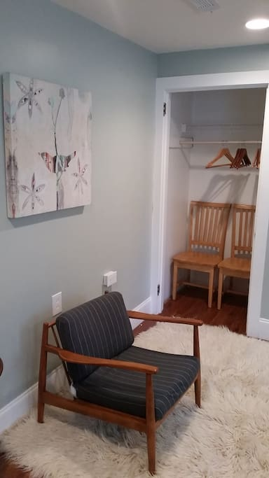 Room is furnished with quality furniture, art, and rugs.