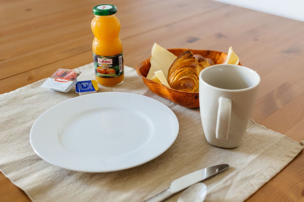 Continental breakfast is included: butter croissant or toast, juice, coffee or tea, butter, jam.