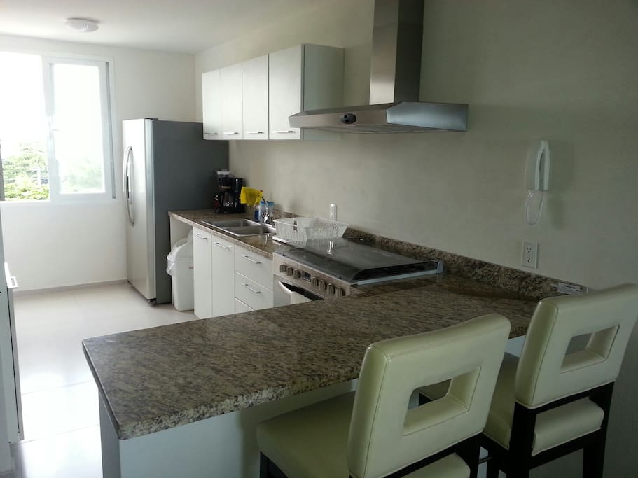 Fully equipped kitchen with all appliances and accessories ready to use