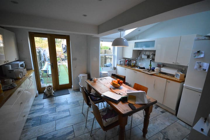 The kitchen with fridge freezer, microwave, cooker, washing machine and dishwasher