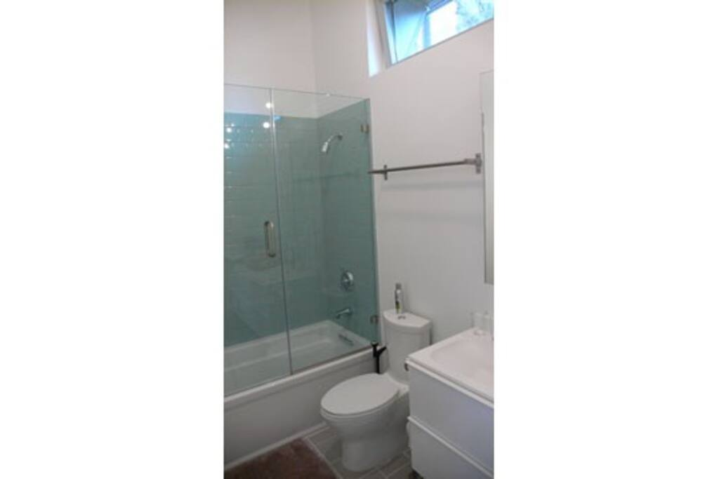 Bathroom, with soaking tub, shower and radiant heat floor tiles in winter.
