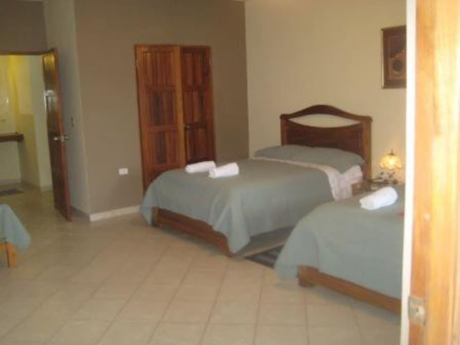Huge Family Room sleeps 5 in 2 double and 1 twin.  Private bath, TV, AC
