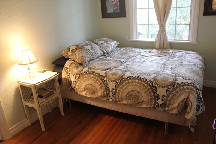 Your bedroom with a comfy queen bed.