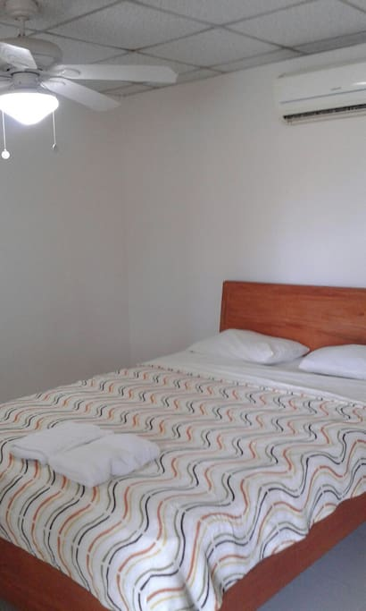Nice size room sleeps 3 in 1 queen and 1 twin bed.  Private bath,  AC, ceiling fan, large covered veranda.