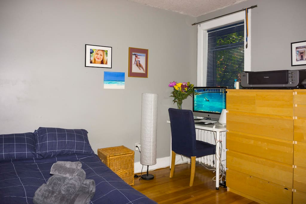 The room is configured as a day-office that makes into a temporary bedroom