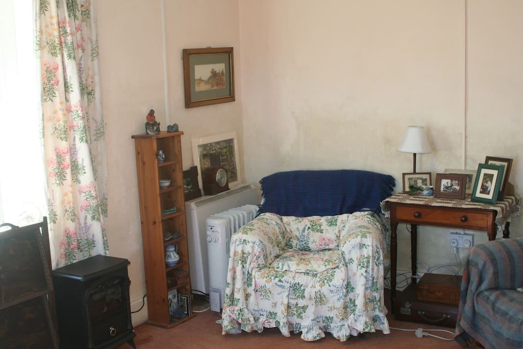 Sitting room with a collection of country books, games, etc. Old style gramophone with a selection of classical LP's.