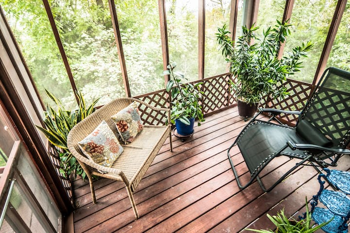 Private screened-in sitting porch right off the bedroom
