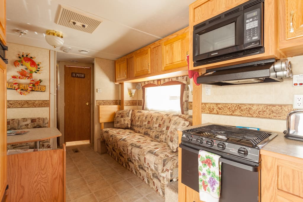 Very efficient and fully equipped kitchen and dining area.