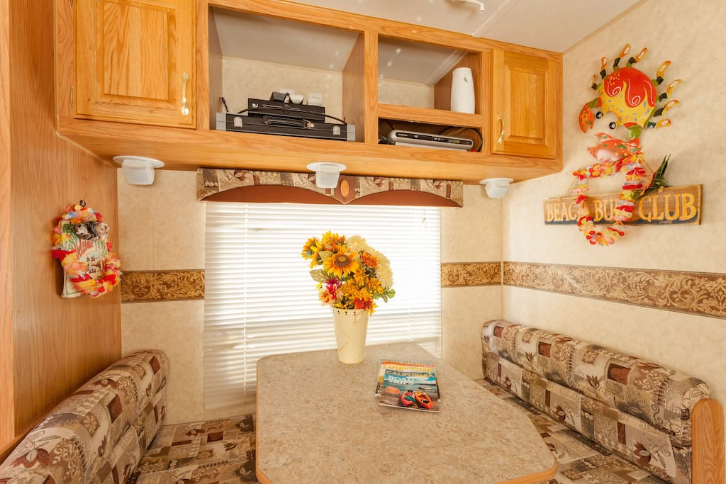 Dining and entertainment area. The flat screen tv sits on the table when viewing.