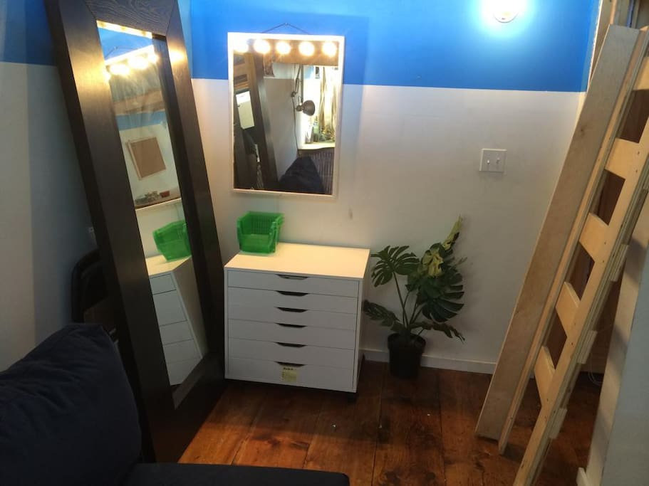 Free space in white desk, makeup organizer and vanity mirror. Full size mirror. The ladder is attached to the bed (this is an old pic..)