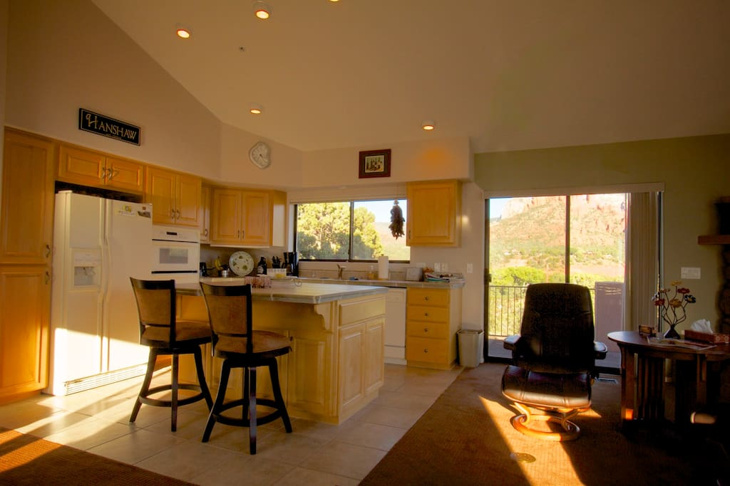 Open concept kitchen with access to wrap around deck .