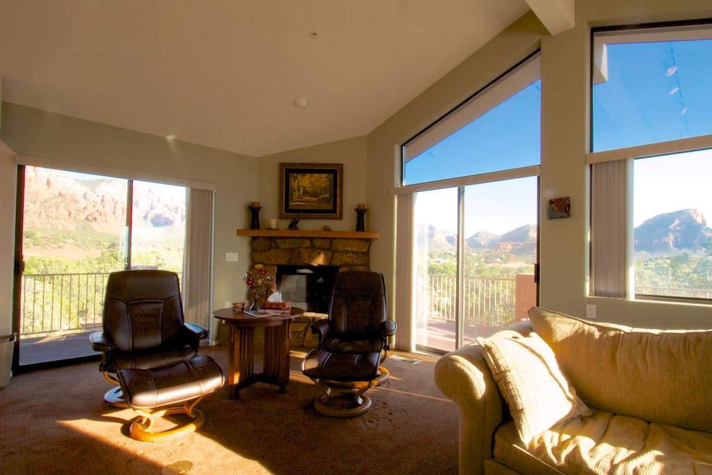 Great room with fireplace, views and access to wrap around deck.
