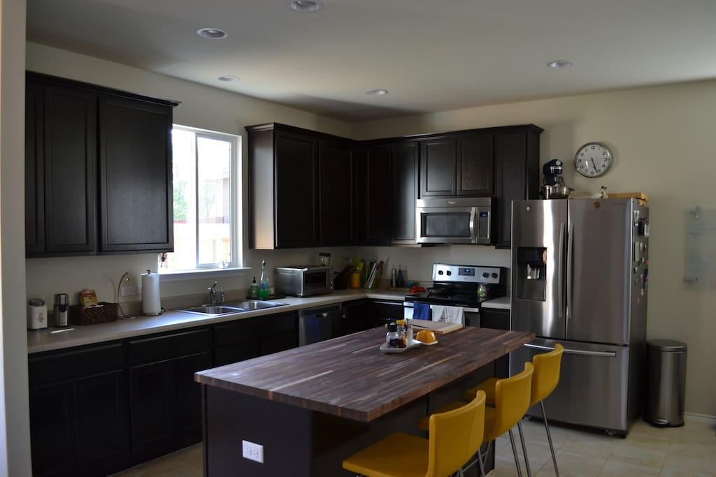 Full kitchen and island for cooking and entertaining.