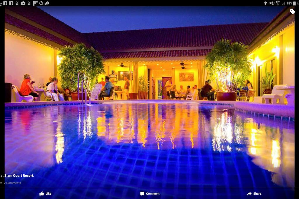 Sitting out at night by the pool at siam court  Atsiam court
