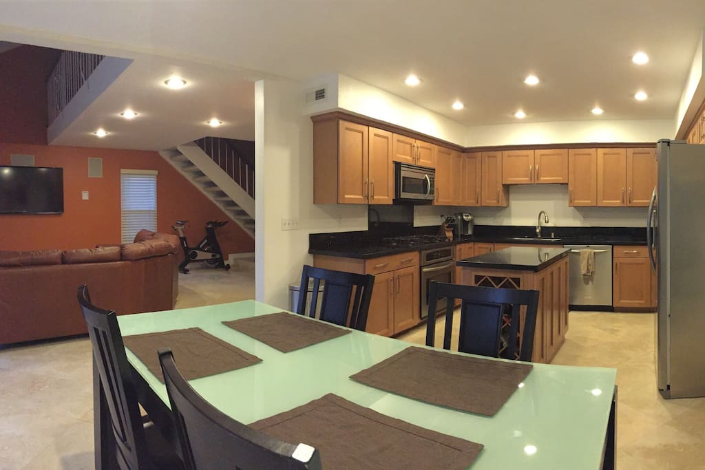 Approximately 900sqft of open concept downstairs entertaining space.