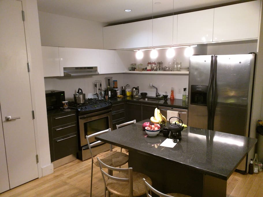 Large open kitchen with stainless steel appliances.