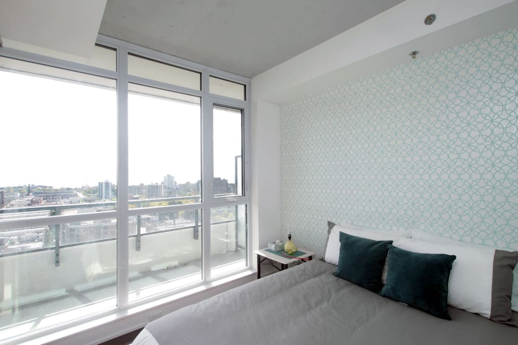 The master bedroom has a queen size bed and a southern exposure; you can see the lake in the distance