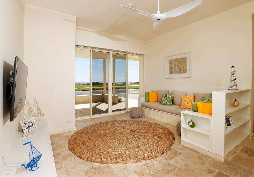 Separate downstairs living area looking out to sea, guests or children can relax away from adults entertaining upstairs