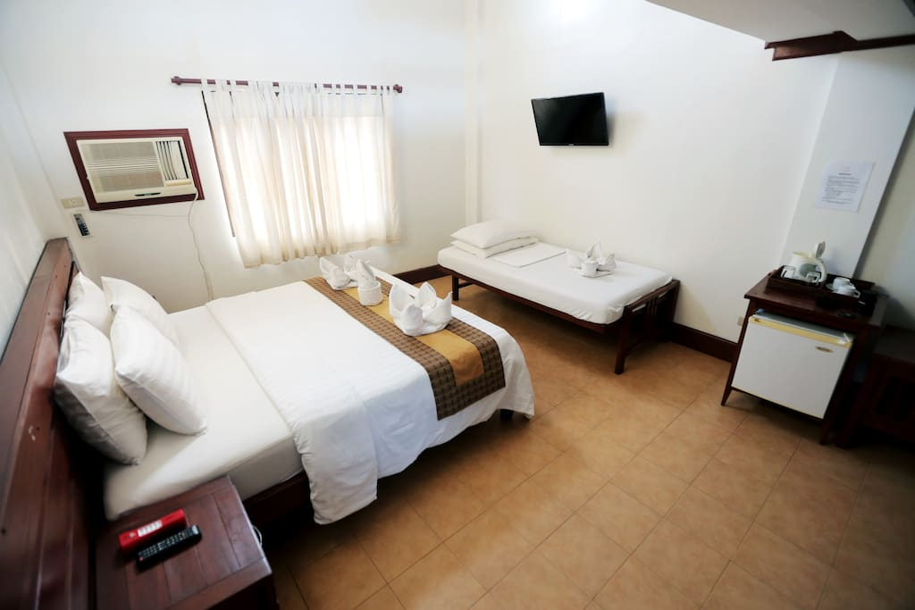 Basic room amenities such as a/c, cable tv, and ref are available.