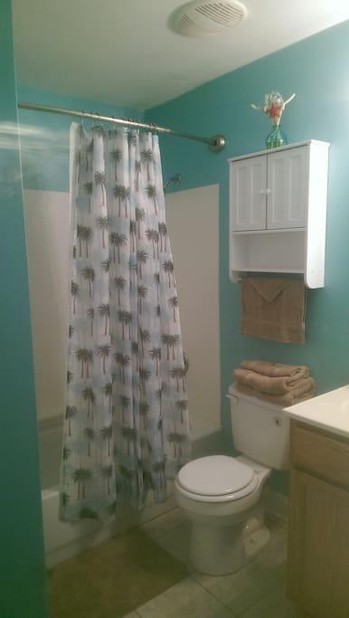 plush towels, bath cloths shampoo, soap and crest toothpaste