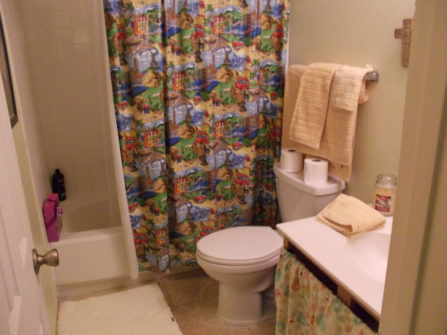 Private bathroom   within the first room.  Tub and shower. TP , towels and hand soap and shampoo provided for guests.
