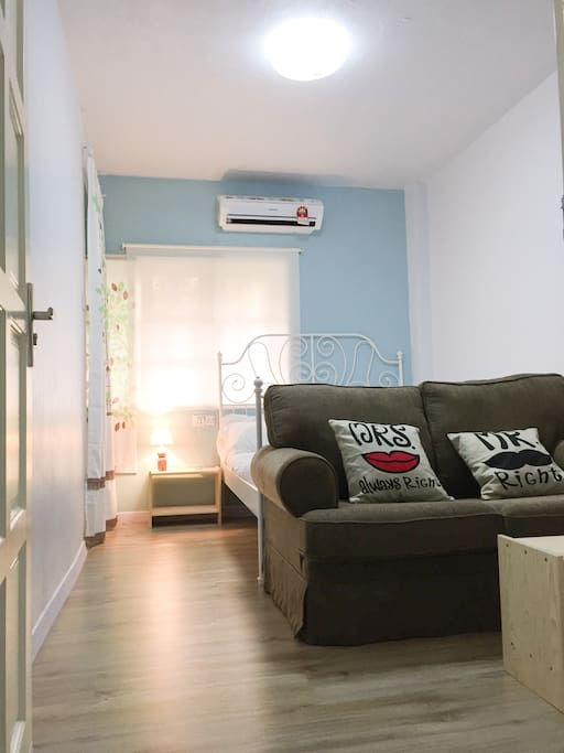 Suite Room with Double bed, sofa, coffee table, TV, Air conditioner, wardrobe and private bathroom
