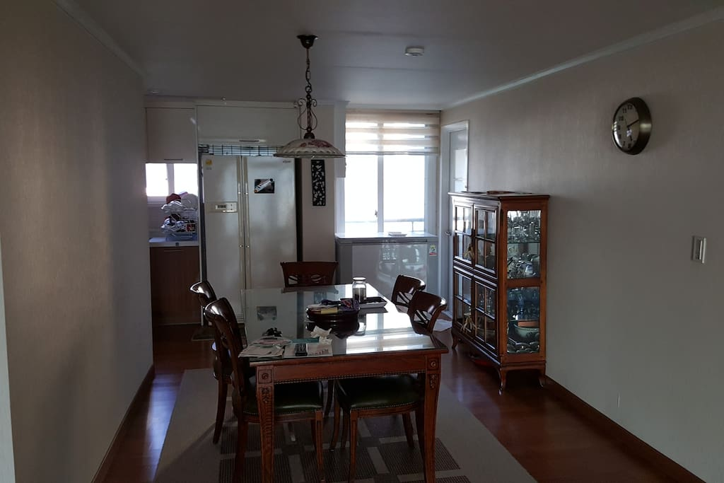 Dining room with kitchen  Wahing M/C available in door on the right corner, which isn't shown in the photo