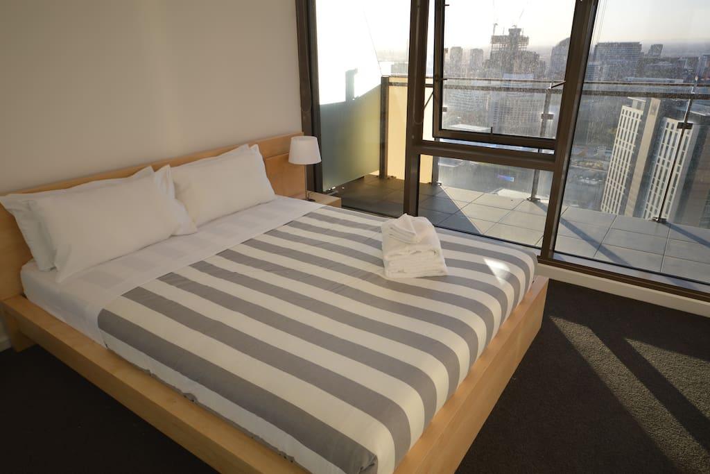 The main bedroom has stunning city views