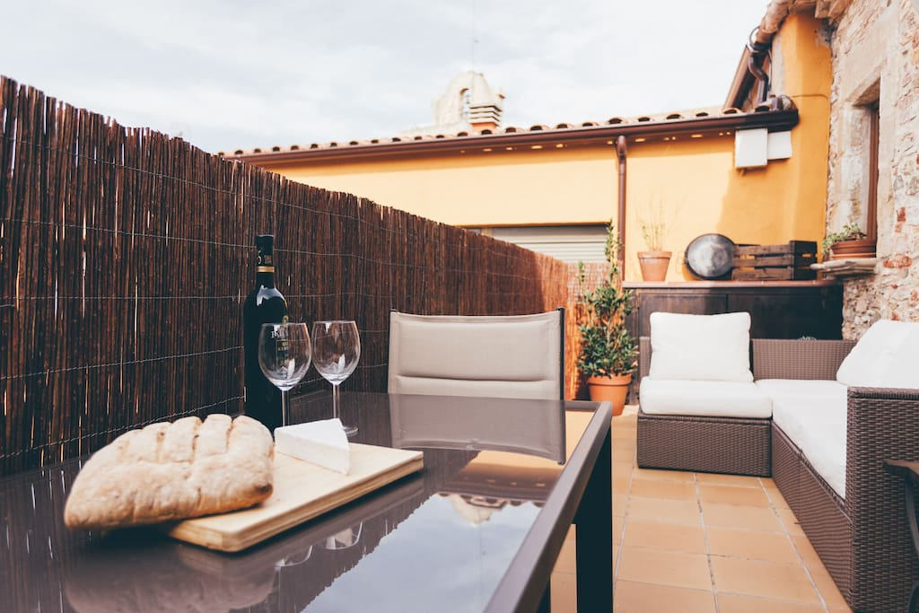spacious terrace with dining table and lounge area