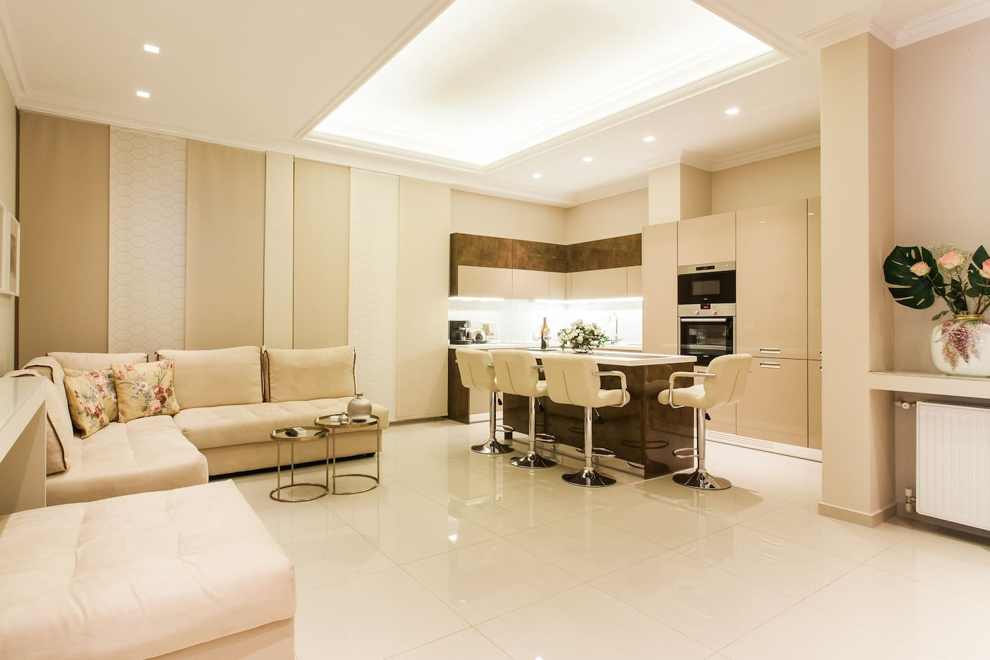 Open concept living room with kitchen island [Registration Number: 00000126409]