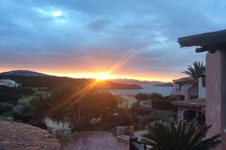 """Beautiful apartment Porto Cervo """"Cala del Faro"""". In the living room with sofa bed and possibility of a single bed."""