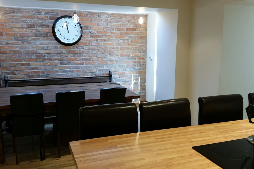 Kitchen/dining room with breakfast bar and table seating up to 10 people