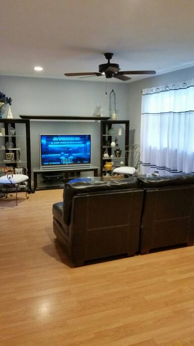 "1st floor living room with 52"" TV,"