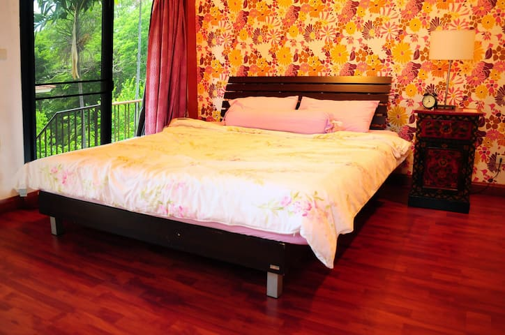 The bedroom is large and spacious with a king size bed and, a garden view next to your bed connected to the balcony. Private bathroom inside the bedroom.