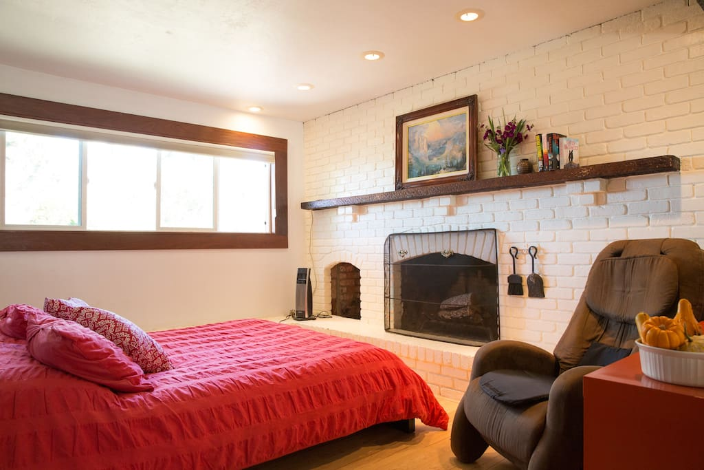 Queen bed with working fireplace