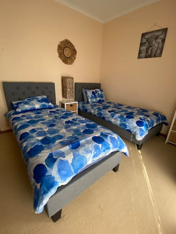 3rd bedroom with 2 single beds and BIR.