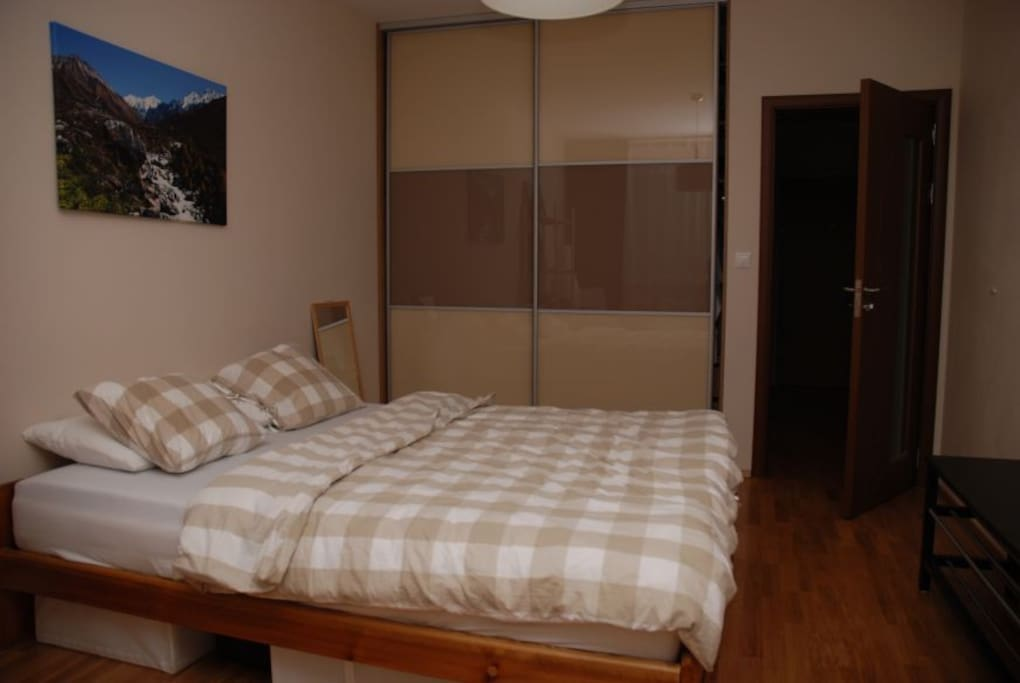 Large room, wooden floor, wardrobe, quite and sunny