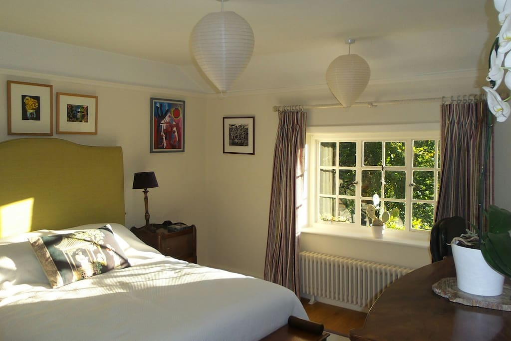 South facing  Comfortable bedroom with view onto magnificent garden